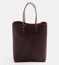Tall Leather Tote Bag | Made with thick, rugged leather, this tote is handcrafted to a... | Tote Handbags