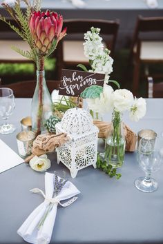 Tres Chic Affairs | Twinkle & Toast | San Diego Botanic Garden | Wedding | succulents| bespoke | florals | protea | table number | grey | bottles | grape wood | lantern | lavender | Scott Lamoreaux Photo