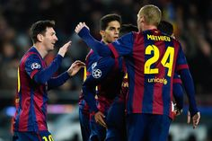 Lionel Messi (L) of FC Barcelona celebrates after scoringm their first goal during the UEFA Champions League group F match between FC Barcelona and Paris Saint-Germanin FC at Camp Nou Stadium on December 10, 2014 in Barcelona, Catalonia.