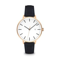 """Rose gold case and navy leather strap. """"The Minimalist"""" watch by LINJER features a lacquered varnish dial and refined detailing."""
