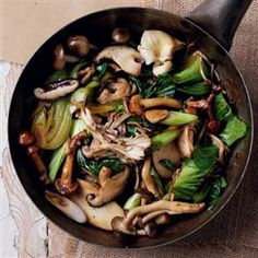 Oriental mushroom and pak choi stir-fry. (Serves 2) 2½ tbsp sunflower oil, 500g mixed oriental mushrooms (we used yellow, chestnut and king oyster, enoki, nameko, maitake, shimeji and shiitake), 1 shallot, finely chopped, 2 garlic cloves, finely chopped, 2.5cm piece fresh ginger, finely chopped, 3 pak choi, quartered, 1 tbsp rice wine vinegar, 2 tbsp dark soy sauce, 6 spring onions, sliced.