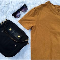 • VINCE. • V-Neck T-Shirt A rich, vivid hue updates a classic V-neck T-shirt cut from soft, pima-cotton jersey. True color in first pic Vince Tops