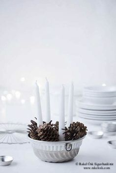 candle holder and pinecones