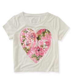 "Even if you're picky about what you wear, you'll be impressed by our Cropped Floral Like Graphic T! This boxy top displays a giant rose-print heart that's detailed with sequins and ""Like"" text. Rock it with a flouncy skirt and your look will earn lots of thumbs up!<br><br>Tag free label.<br>Relaxed fit. Approx. length (10): 16""<br>Style: 2449. Imported.<br><br>100% polyester.<br>Machine wash/dry."
