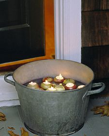 """""""Apple Votives Tutorial  A flotilla of apples bobbing in a steel tub evokes memories of  childhood and headlong plunges into icy water. But carved into holiday  candleholders, these apple votives are a prize for the eyes alone, their  flames a promise of warmth.  Tools and MaterialsSimilar steel tub (C-50), $38.90, from Bevo WorksApplesTea lightsParing knifeLemon juice  Apple Votives How-ToEvery apple will float differently, so see how they balance in water before marking their topsides with"""
