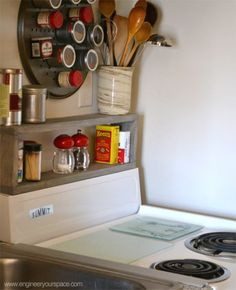 Add a DIY shelf above the stove to store large spice containers and cooking utensils.