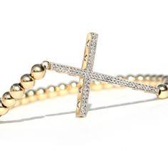 Martha Calvo 14kt. Gold Diamond Cross bracelet