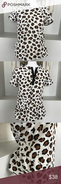 Zara Printed Weave Peplum Cheetah Print Blouse The cutest shirt! Perfect for Fall with dark jeans and boots. The back is more of a peplum fluttery look. The shirt itself is a textured pebbles look and feel. Zara Tops Blouses