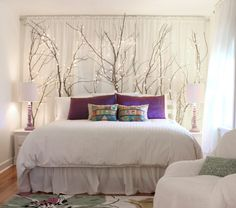 Ideas for using branches as indoor decor- here, placed behind a headboard - hawk-hill.com