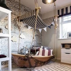 Nautical kids bedroom with ship bed and striped awning for a mast.