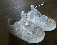 These tiny converse are perfect for busy little party feet. They are customized with lace, pearls and ribbon.  * White mono converse * Size 4