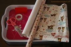 Give your child all the supplies they need to wrap their own gifts in this work center: wrapping paper, tape, scissors, gift tags, ribbons, pen.