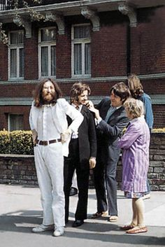 The Beatles about to cross Abbey Road.
