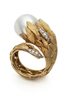 A cultured Pearl set in Yellow Gold leaves with pave-set Diamonds