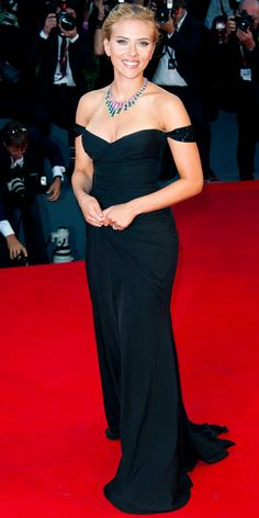 At the Venice Film Festival Under the Skin premiere, Scarlett Johansson made an entrance in a black chiffon Versace gown with embellished off-shoulder straps and draped bodice. A beautiful statement Bulgari High Jewelry necklace was the finishing touch.
