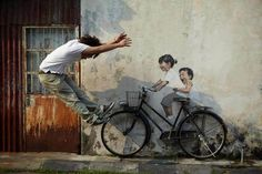 Interactive Street Art in Malaysia by Ernest Zacharevic.  Ernest Zacharevic is a Lithuanian street artist currently living in George Town, located in the province of Penang, Malaysia. As part of the George Town Festival that runs from June 15 – July 15, Ernest has been putting up some incredible street art all around the city.