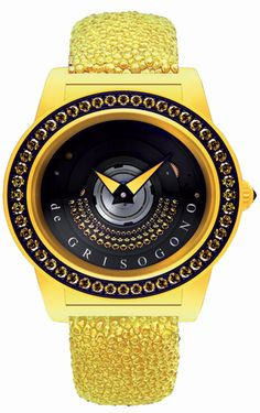 The de Grisogono Tondo By Night watch Collection, Luxurious and technical.  A line that is at once playful, luxurious and technical. The refined art of gemsetting blends smoothly with the technical sophistication of an exclusive in-house movement specially developed to display a gemset oscillating weight on the front side. The spectacular models sparkle both by day and night thanks to an original pearly photoluminescent composite fiberglass material. http://www.luxuriousmagazine.com/?p=13171