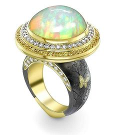"Theo Fennell ""Bella Donna"" Ring with a 15.34ct cabochon Ethiopian Opal, surrounded by diamonds and yellow sapphires"