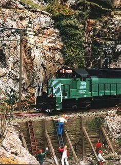 Beaver & Timber Springs - BN 6335 slides past the repair crew.