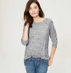 Cooly seamed and stitched for a sporty nod, this featherweight tee is a true closet staple. Round neck. 3/4 sleeves. Side slits.