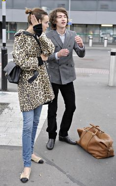 Alex Turner and girlfriend Alexa Chung are pictured flying into Heathrow airport from Los Angeles.
