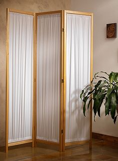 "Fabric Folding Floor Screen    A folding screen can give any room a whole new look! A great way to create private spaces by dividing rooms or use as a decorative piece. Each panel is 17""W x 71""H. The fabric is a polyester/cotton blend.    Available in White, Cherry and Natural."