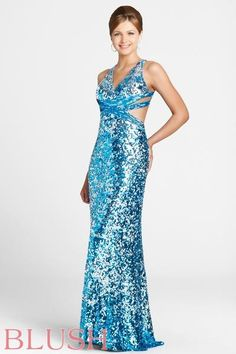 Fantastic and sparkly in this blue-silver beaded gown with side cutouts and a strappy open-back.