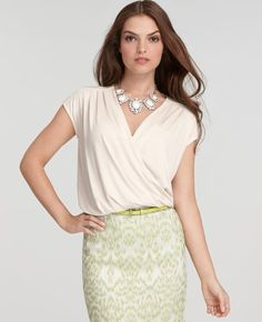 Banded Hem Cap Sleeve Top...Ann Taylor   the banded hem fits under skirt/pants and the blouson effect is always perfect!