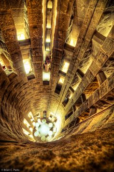 https://flic.kr/p/cpBeao   La Sagrada Familia Tower Stairwell in Barcelona, Spain   After braving the towers of La Sagrada Familia, it was on to the spiral staircase that was the only way down. It's a good thing I'm not claustrophobic. The staircase looked like the inside of a seashell, one person wide and spiraling down around an opening about a foot wide...  Read more...