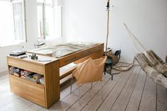 Another way to hide the bed: Turn it into a desk (Literally) : TreeHugger