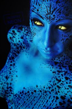 An absolutely gorgeous Mystique cosplay. Love the body paint and makeup. - 12 Mystique Cosplays