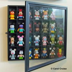 Great way to display Vinylmation: Shot glass display case from ...