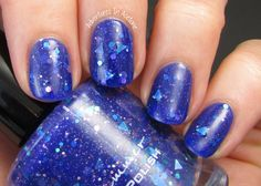 KBShimmer Winter 2014 Collection (Partial)  KBShimmer Fallen Angle A vibrant royal blue jelly, this a-cute polish features holographic blue triangles, silver holo hexes, and blue hex glitters with micro sparkles. I'm showing three coats below with top coat. Loving the triangles!