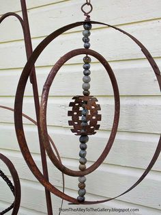 From The Alley To The Gallery: Whiskey Barrel Ring Hangings