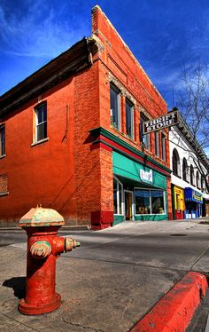 Thrift store on street in Logan, Utah. View large - 'Repaint, Reuse, Recycle' On Black