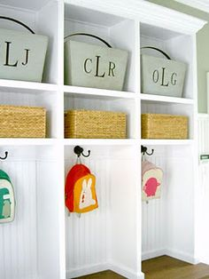 precious monogrammed bins. love this and I think it could work by a front door/back door. No mud room needed.