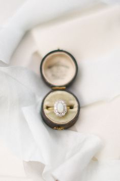 Opal cabochon + diamond halo | Photography: Ivy & Stone Photography - www.ivyandstonephotography.com