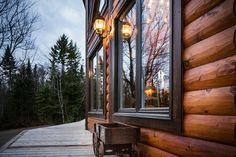 log home with black trim windows
