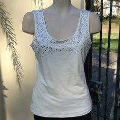 Top Really cute tank with silver studs & rhinestones. Can dress up or down any outfit. NWOT Cache Tops Tank Tops