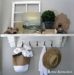 See this entryway here. You can get similar hooks for $5.39 each here.