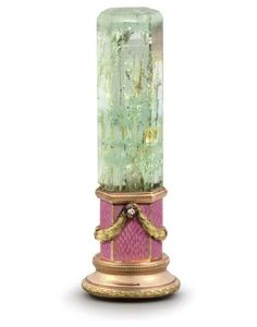 A RUSSIAN GUILLOCHÉ ENAMELLED TWO-COLOUR GOLD-MOUNTED GREEN BERYL HAND-SEAL MARKED FABERGÉ, WITH WORKMASTER'S MARK OF MICHAEL PERCHIN, ST. PETERSBURG, 1896-1908, WITH SCRATCHED INVENTORY NUMBER 6799 The facetted handle with conforming mount guilloché enamelled in pink and applied with diamond-set foliate swags, with milled and foliate borders, plain matrix.