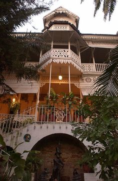 Hotel Oloffson, Port-au-Prince - Scene from Haiti Architecture Unique, Greater Antilles, Celebrity Cruises, Princess Cruises, Tropical, Vacation Destinations, Italy Vacation, West Indies, Romantic Travel