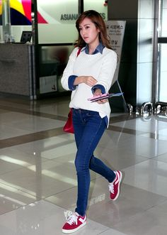 Jessica's Airport Fashion: White sweater layered over denim collar shirt with jeans and red sneakers