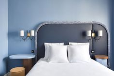 We're loving the asymmetrical, velvet-trimmed, tone-on-tone headboards at the Hotel Bienvenue in Paris by Chloé Nègre, a former protegée of India Mahdavi.