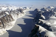 NASA - IceBridge Flight Over Baffin Island; ice covered fjord on Baffin Island with Davis Strait in the background. Glaciers Melting, University Of Colorado, Image Of The Day, Weekend Is Over, British Columbia, Continents, Alaska, Beautiful Places, Adventure
