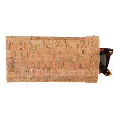 """The Cork Eyeglass Case will fit most eyeglasses and oversized sunglasses. Features include: Real cork fabric. Cork is durable, lightweight and water-resistant! Secure squeeze top frame 3.5"""""""" H x 7"""""""" W"""