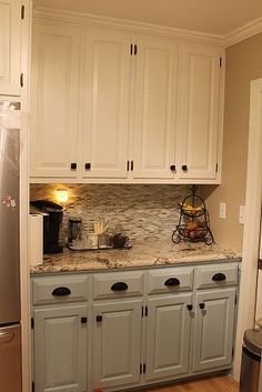 Same Kitchen renovation. Love mint green/grey and cream cabintery and hardware (drawer & cabinet pulls)