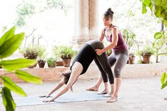 Woman teaching another woman yoga