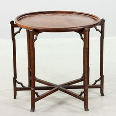 "Early 20th century Japanese hardwood stand, 26 1/2"" h x 29 1/2"" w."