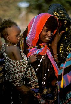 Africa | Woodabe women, one with a child, photographed at the Gerewol Festival. Tahoua Niger | © deepchi1 on flickr